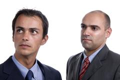 Stock Photo of two young business men portrait on white