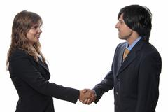 business partners are shaking hands on a deal - stock photo