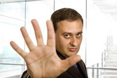 Business man making stop Stock Photos