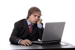 Stock Photo of young man working with his personal computer