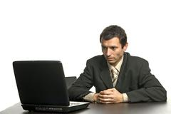 young man wondering and working with is laptop - stock photo