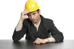 Stock Photo of engineer yellow hat, isolated on white