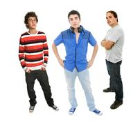 three young man full length, isolated on white - stock photo
