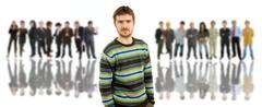 young man in front of a group of people - stock photo