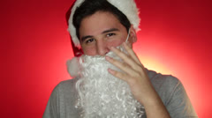 An Asian guy with Santa Claus cap and beard Stock Footage