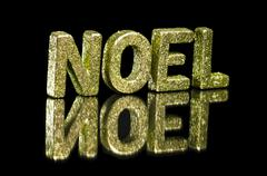 In capital letter written noel, glitter effect Stock Photos