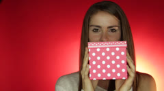 American lady holds the box and provides great smile Stock Footage