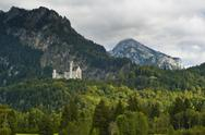 Stock Photo of castle neuschwanstein with alps in the background