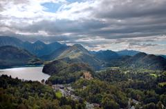 castle hohenschwangau with alps in the background - stock photo