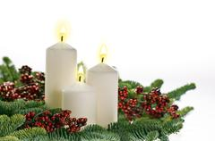Three candles in advent setting Stock Photos