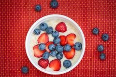 Hot oatmeal breakfast with fresh fruits Stock Photos
