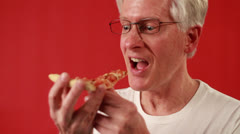 Old American man eats the oven-baked flat bread Stock Footage