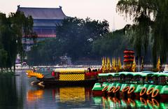 Stock Photo of houhai lake tourboats reflections drum tower in background, beijing, china