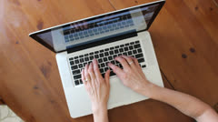 woman typing on a computer keyboard - stock footage