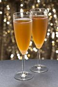 champaign glass in front of glitter background - stock photo
