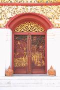 Carved wood door of church. Stock Photos