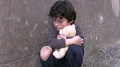 Homeless poor little boy - stock footage