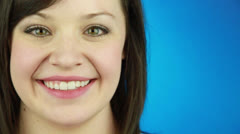 A smiling girl at the blue background Stock Footage