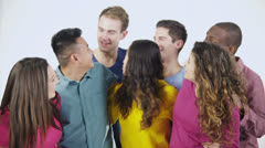 Happy, diverse group in casual clothing, isolated on white in a studio shot - stock footage