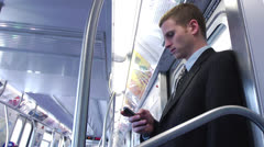 Business Man Using Smartphone on Clean Subway - Close Profile Shot Stock Footage