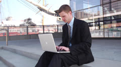 Business Man Sitting On Steps and Using Laptop Stock Footage