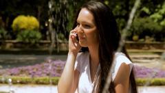 Happy beautiful girl is speaking on mobile phone. Stock Footage