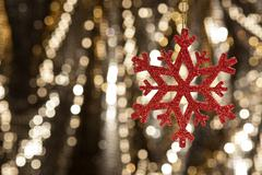 red snow flake on a gold glitter background - stock photo