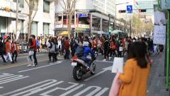 People crossing the crosswalk Stock Footage