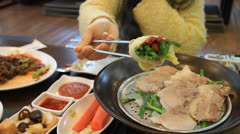 How to eat Bossam - Korean traditional boiled pork Stock Footage