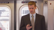 Stock Video Footage of Man Using Smartphone in Subway - Above Ground