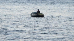 Man in Dinghy Checking Crab Trap Stock Footage
