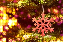 red snow flake in a christmas tree with neon colors - stock photo
