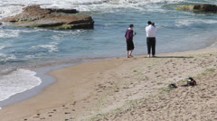 Religious Jewish family by the sea Stock Footage