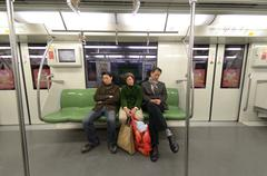 people traveling in shanghai's metro - stock photo