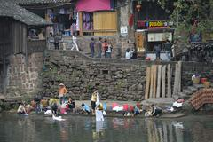 Chinese women doing laundry in the river - stock photo