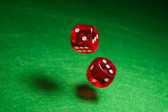 rolling red dice - stock photo