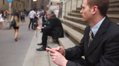 Business Man Sitting on Steps with Cell Phone - stock footage