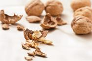 Opened and whole walnuts Stock Photos