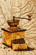 Coffee mill and beans in grunge style Stock Photos