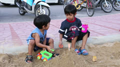 Two Asian Kids Playing In Sand Box At Park Stock Footage