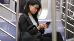 Woman Viewing Cell Phone on Clean Subway - stock footage