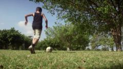 Children playing football match, group of young kids having fun, soccer game Stock Footage