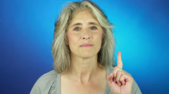 The Aged Blonde Lady Counting Numbers in Her Fingers Stock Footage