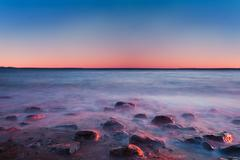 sea at sunrise with motion blur water - stock photo