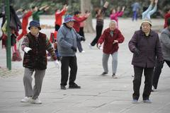 seniors practicing tai chi - stock photo