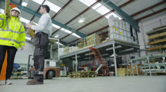 Time lapse of busy warehouse workers lifting and moving goods and materials Stock Footage