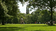 Stock Video Footage of Park scene, leisure summer activity, Bicycle leaning at tree