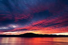Amazing fiery burning evening sky Stock Photos
