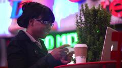 Woman Using Laptop in Timesquare - Medium CloseUp Stock Footage