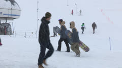 Snowboarders walking on the snow Stock Footage